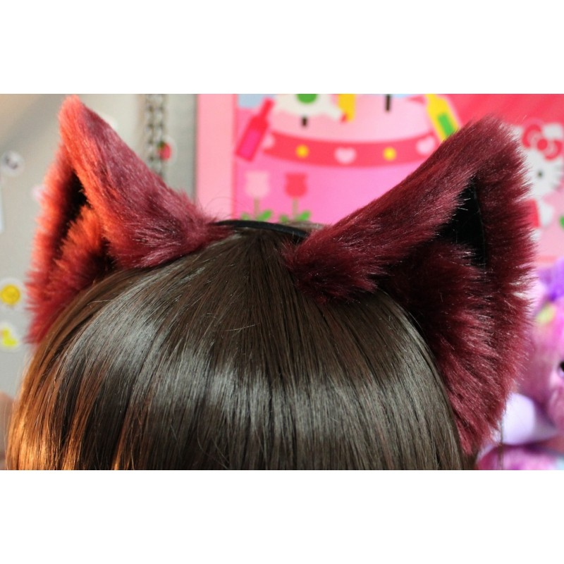 Step One: The Ears. So, here's how to make your own. You'll need some felt (black and pink, or black and white), one of those cheap fabric headbands you can buy at the grocery store, and a needle with some thread. Cat ears are mostly triangular, but have a bit of width near the bottom. Cut out one ear, and then use it as a stencil, so that your second ear matches.